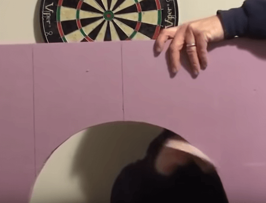 sanding down the dartboard backboard
