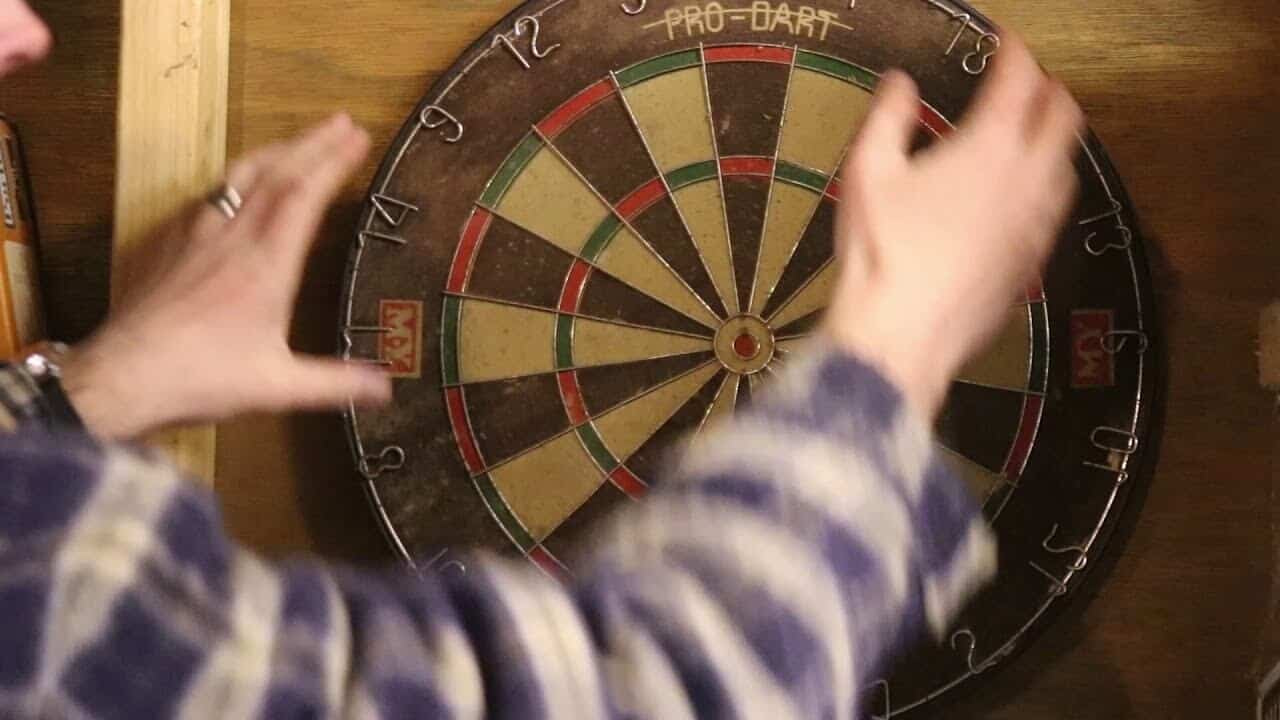cleaning a dartboard